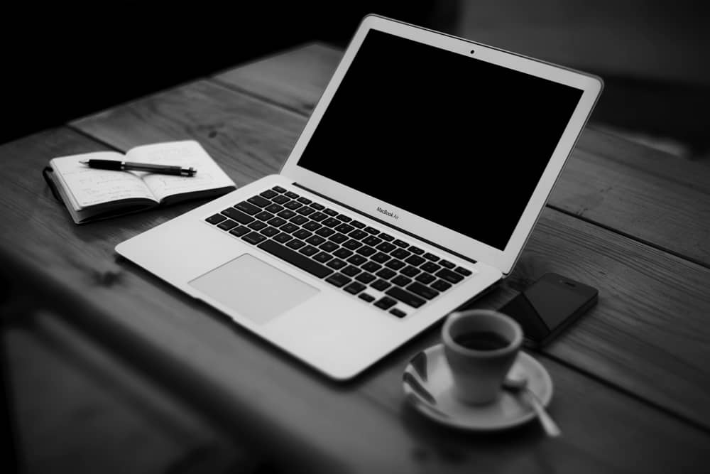 Laptop-with-espresso-and-notes